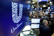 The logo for Unilever appears above a trading post on the floor of the New York Stock Exchange.