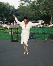 Aretha Franklin stands on the front lawn of her home in Bloomfield Hills before a fundraiser in July of 1987 for presidential candidate, Rev. Jesse Jackson.