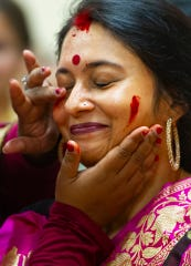 Sukanya Gupta of Newburgh celebrates Durga Puja with a traditional red powder, gulal, at the Tri-State Hindu Temple, Newburgh, Sunday night, Oct. 6, 2019.