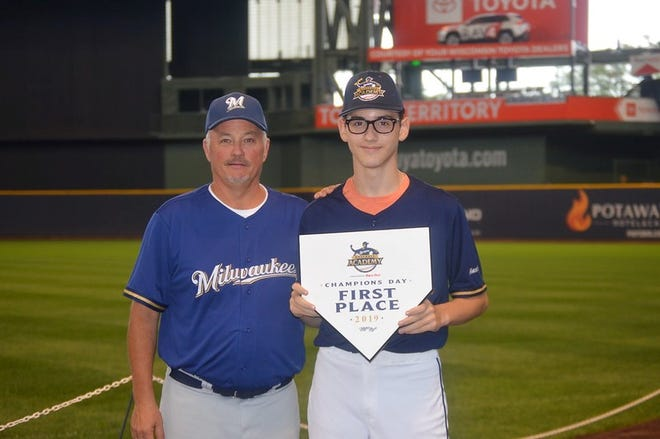 Ray Aguilar-Meza, eighth grader at Theisen Middle School, finished first at the Milwaukee Brewers Academy Champions Day competition held last month at Miller Park. Milwaukee Brewers Academy Field Director David Eagan presented the award.