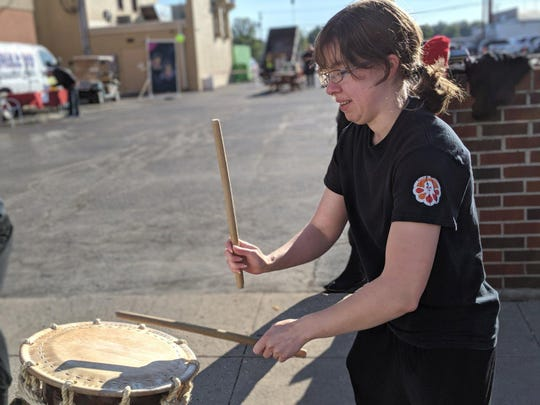 Anne Kessing of Kazenodaichi Taiko, plays a Japanese drum called a Taiko during the Crop Circle Festival Saturday in downtown Fremont