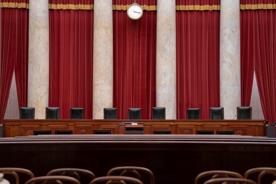 FILE - In this June 24, 2019 file photo, the empty courtroom is seen at the U.S. Supreme Court in Washington. (AP Photo/J. Scott Applewhite)