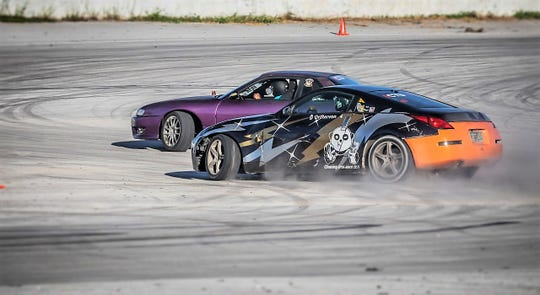 Von Burrell chases down Jaimee Mendiola during their battle for 3rd place during Round 5 of the Proline Drift Series at the Guam International Raceway.