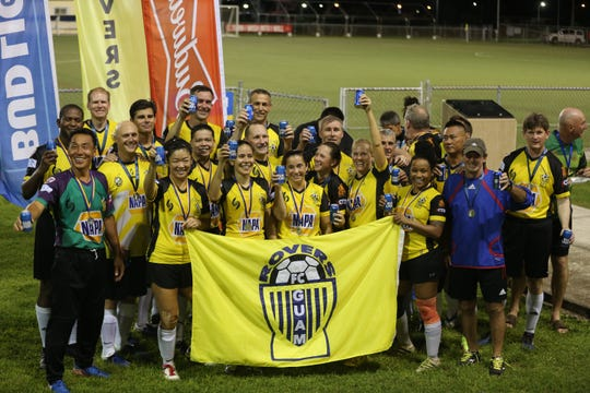 The NAPA Rovers Masters pose for a group photo after accepting the champions trophy and gold medals of the Bud Light Co-Ed Masters Soccer League during an awards ceremony following the championship match held Sept. 28 at the GFA National Training Center. The NAPA Rovers Masters defeated 2018 champions, Bank of Guam Strykers Masters, 3-1.