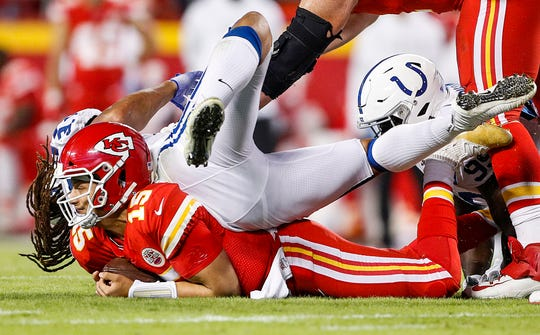 Indianapolis Colts defensive end Justin Houston (99) sacks Kansas City Chiefs quarterback Patrick Mahomes (15) during the second quarter of their game at Arrowhead Stadium in Kansas City, Mo., on Sunday, Oct. 6, 2019.