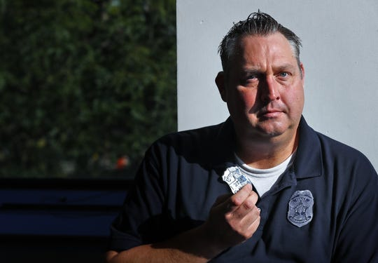 IMPD Officer Eric Strange show his old IPD badge, Friday, Sept. 27, 2019.  He was the officer who took the guns from Kenny Anderson just months before Anderson went on a shooting spree that claimed the life of Officer Jake Laird, Anderson's mother, and left multiple officers wounded.  After years of silence, Strange speaks out about the incident, and he wants to fight for the establishment of Red Flag laws nationwide to prevent incidents like this from ever happening again.