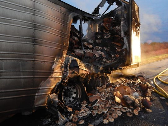 A semi hauling 38,000 pounds of frozen bagels went up in flames Sunday while driving on I-65 about six miles south of Rensselaer, Indiana, state police said.