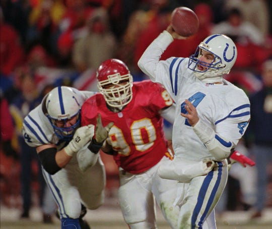 Colts quarterback Jim Harbaugh attempts a pass against the Kansas City Chiefs in the AFC Divisional playoffs at Arrowhead Stadium on Jan. 7, 1996.
