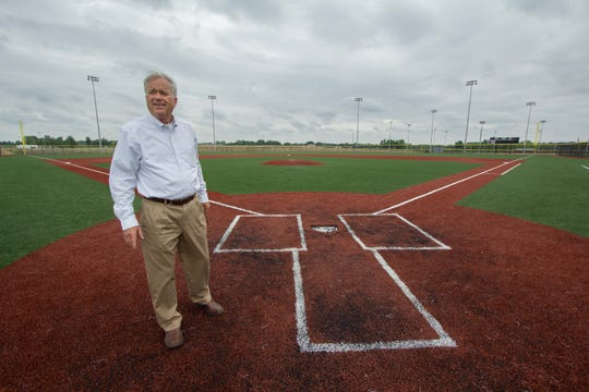 Westfield Mayor Andy Cook stands near home plate on the championship baseball field at the 400-acre Grand Park sports complex, June 10, 2014.