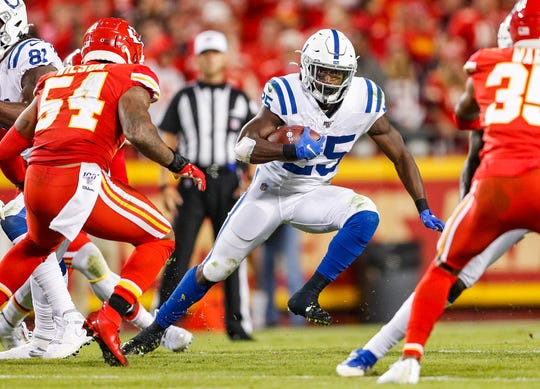 Indianapolis Colts running back Marlon Mack (25) runs the ball during the third quarter of their game at Arrowhead Stadium in Kansas City, Mo., on Sunday, Oct. 6, 2019.