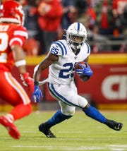 Indianapolis Colts running back Marlon Mack (25) looks for a place to run during the second quarter of their game at Arrowhead Stadium in Kansas City, Mo., on Sunday, Oct. 6, 2019.