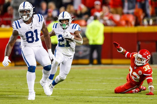 Indianapolis Colts tight end Mo Alie-Cox (81) blocks as running back Nyheim Hines (21) runs the ball and Kansas City Chiefs strong safety Tyrann Mathieu (32) trails behind during the third quarter of their game at Arrowhead Stadium in Kansas City, Mo., on Sunday, Oct. 6, 2019.