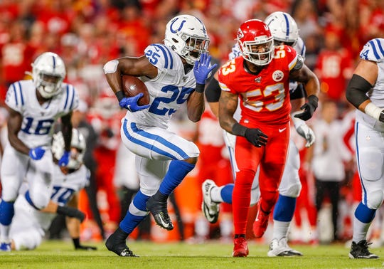 Indianapolis Colts running back Marlon Mack (25) runs the ball during the first quarter of their game at Arrowhead Stadium in Kansas City, Mo., on Sunday, Oct. 6, 2019.