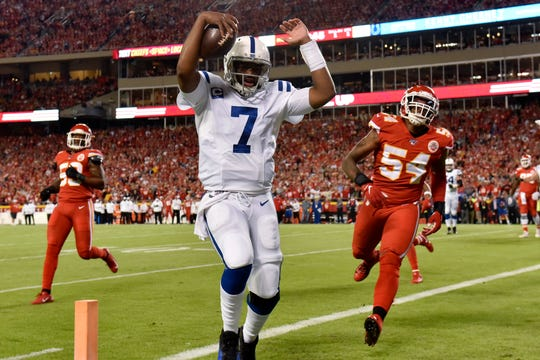 Indianapolis Colts quarterback Jacoby Brissett (7) scores a touchdown next to Kansas City Chiefs linebacker Damien Wilson (54) during the first half of an NFL football game in Kansas City, Mo., Sunday, Oct. 6, 2019.