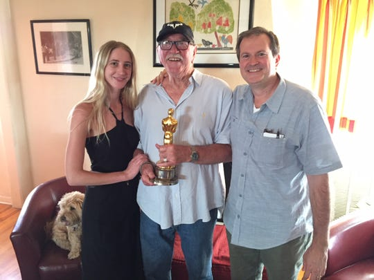 """Writer/Director Robert Jury poses for a picture with the film editors on """"Working Man."""" Richard Halsey (center) holding his Academy Award for """"Rocky,""""  and his daughter Morgan Halsey (left)."""