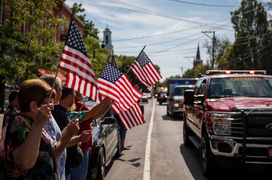 A memorial procession for Sgt. James Johnston, who was killed in Afghanistan in June, passes through Trumansburg, N.Y., Saturday, Aug. 31, 2019. Two months after his death, his adopted hometown had come together over a holiday weekend to pay tribute, and to say goodbye. (AP Photo/David Goldman)