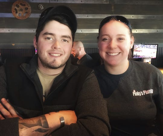 This January 2019 photo provided by Paula Kovach shows her nephew, James Johnston, and his wife, Krista, in Killeen, Texas. The two met in high school and both enjoyed the outdoors. (Paula Kovach via AP)