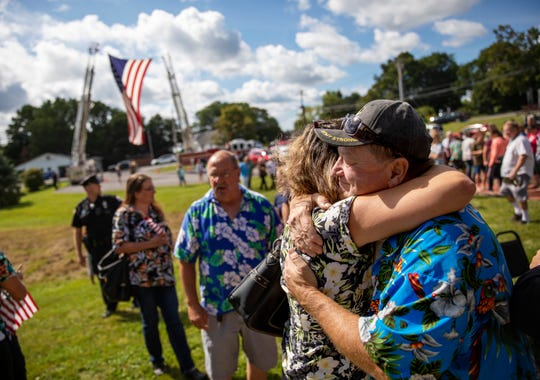 Fred VanDerzee, right, is embraced by Sarah Short at a memorial service Saturday, Aug. 31, 2019, in Trumansburg, N.Y., for his son-in-law, Sgt. James Johnston, who was killed in Afghanistan in June. (AP Photo/David Goldman)