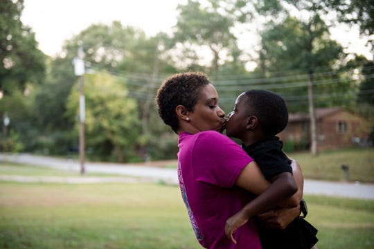 Greyson Gross kisses his mom, Kendra Strickland, outside their home in Jackson on Wednesday. Greyson is 4-years-old and has autism, but excels in his education at a higher level than most children.