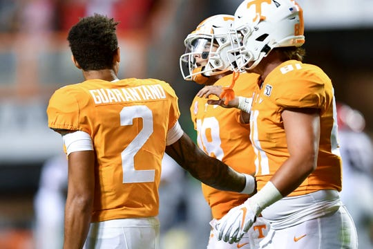 Tennessee quarterback Jarrett Guarantano (2) checks on quarterback Brian Maurer (18) after he was sacked by Georgia defensive back Eric Stokes (27) on Saturday, October 5, 2019.