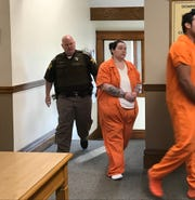 Jasmine Parker, one of five people charged in connection to the death of Nicole Bowen, walks into the Newton County Courthouse Monday, Oct. 7, 2019. Parker pleaded guilty Monday to assisting a criminal and was sentenced to five years in prison.