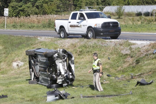 This silver Chevy Impala rolled off the southwest corner of Indiana 26 and Tippecanoe County Road 900 East after it collided with a westbound Buick Rendezvous.