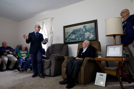 French Consul General to the midwestern United States Guillaume Lacroix, left, speaks at the home of John Steinmetz Monday afternoon, Oct. 7, 2019, in Lancaster. Lacroix presented Steinmetz with the French Legion of Honor.