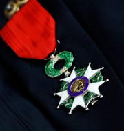 John Steinmetz's French Legion of Honor medal sits on his suit jacket Monday morning, Oct. 7, 2019, in Lancaster. Steinmetz served in the U.S. Navy during World War II and took part in liberation of southern France in August 1944. He was awarded the medal Monday.