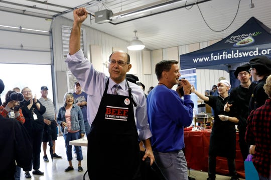 Lancaster City Schools Superintendent Steve Wigton takes a victory lap with his Lancaster High School culinary arts program teammates Monday afternoon, Oct. 7, 2019, in the Ed Sands building at the Fairfield County Fair in Lancaster. Wigton's team won the Plate Your Steaks Celebrity Challenge at the fair. Two LHS culinary arts students were teamed up with a local celebrity and had 45 minutes to cook and plate a steak and two side dishes. The entrants were judged on how well the plates looked.