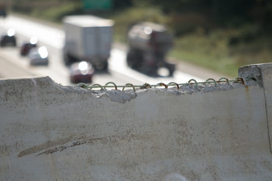 Steel bars that stabilized concrete barricade walls on Chilson Road over Interstate 96 are exposed, due to deterioration, shown Monday, Oct. 7, 2019.