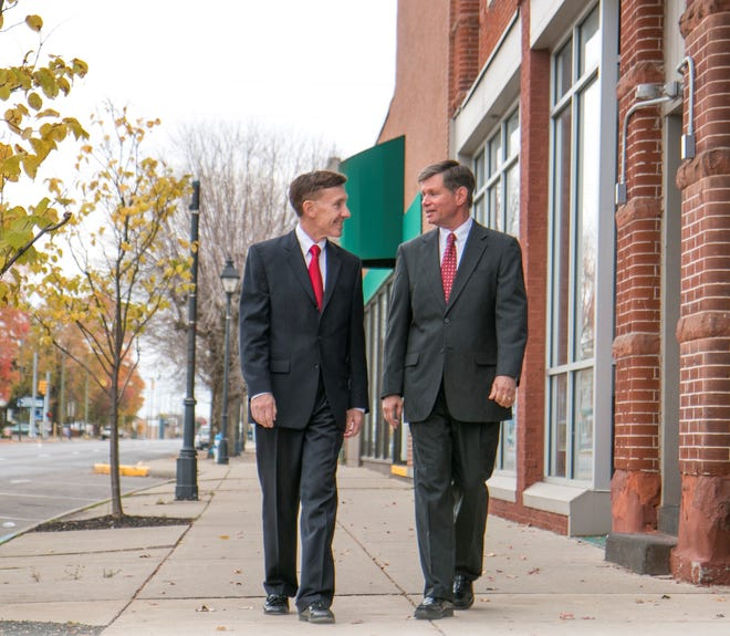 From left, Chuck Mooney and Rev. Kenneth Daniel.