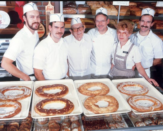 The Olesen family gathered with a signature product of their O&H Danish Bakery in this undated photo. At the center is founder Christian Olesen, who immigrated to Racine from Denmark in 1924.