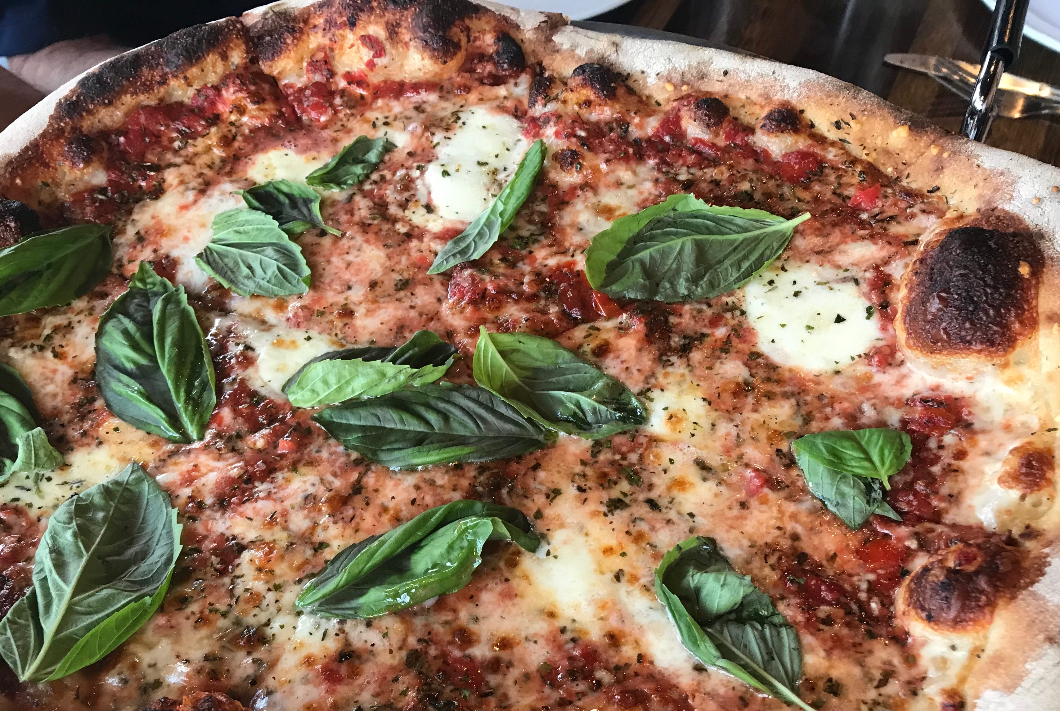 The slow-rise dough develops bubbles in the crust when it's fired in a very hot oven at Wy'east Pizza, 5601 W. Vliet St. This is the Margherita, with fresh mozzarella and basil leaves.