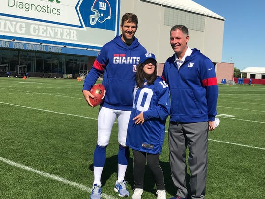 Morris Knolls student Erika Morgan met New York Giants quarterback Eli Manning and head coach Pat Shurmur at practice on Saturday, Oct. 6, 2019.
