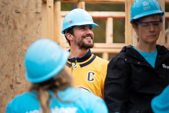 Nashville Predators defenseman Roman Josi joins other volunteers at the Habitat for Humanity build in the the Park Preserve neighborhood of Nashville, Tenn., Monday, Oct. 7, 2019.