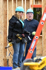 Trisha Yearwood and Tennessean columnist Brad Schmitt work on a home at the start of the Habitat for Humanity build on Monday. Former President Jimmy Carter and his wife, former First Lady Rosalynn Carter, are volunteering along with hundreds of others to construct 21 homes in Nashville.