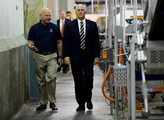 Tyson Foods plant manager Doug Griffin walks through the plant with Vice President Mike Pence during his visit to Tyson Foods Monday, Oct. 7, 2019 in Goodlettsville, Tenn.