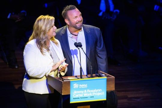 Trisha Yearwood and Garth Brooks speak during the Habitat for Humanity Carter Work Project opening ceremony at the Ryman Auditorium Sunday, Oct. 6, 2019, in Nashville, Tenn.