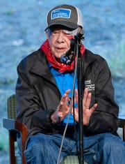 Former President Jimmy Carter leads morning devotions Monday, Oct. 7, 2019, at the start of the week-long Habitat for Humanity build where Carter and his wife, former First Lady Rosalynn Carter, will volunteer alongside hundreds to construct 21 homes in Nashville, Tenn.