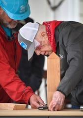 Former President Jimmy Carter works on a corbel at the start of the Habitat for Humanity build on Monday, Oct. 7, 2019. Former President Jimmy Carter and his wife, former First Lady Rosalynn Carter, are volunteering along with hundreds of others to construct 21 homes in Nashville, Tenn.
