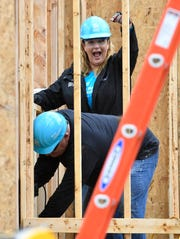 Trisha Yearwood and Tennessean columnist Brad Schmitt work on a home at the start of the Habitat for Humanity build on Monday.