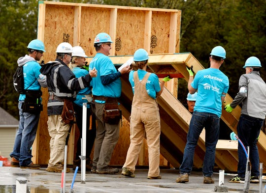 Volunteers work on a home at the start of the Habitat for Humanity build on Monday, Oct. 7, 2019. Former President Jimmy Carter and his wife, former First Lady Rosalynn Carter, are volunteering along with hundreds of others to construct 21 homes in Nashville, Tenn.