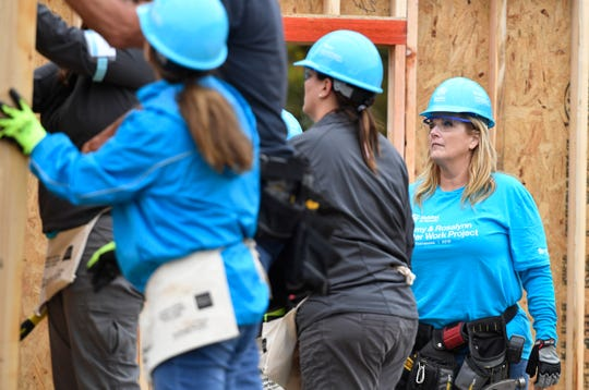 Trisha Yearwood works on a home at the start of the Habitat for Humanity build on Monday, Oct. 7, 2019. Former President Jimmy Carter and his wife, former First Lady Rosalynn Carter, are volunteering along with hundreds of others to construct 21 homes in Nashville, Tenn.