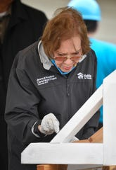 Former First Lady Rosalynn Carter paints a corbel at the start of the Habitat for Humanity build on Monday, Oct. 7, 2019. Former President Jimmy Carter and Rosalynn Carter are volunteering along with hundreds of others to construct 21 homes in Nashville, Tenn.