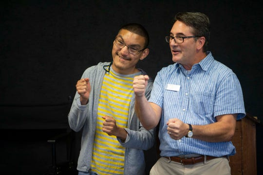 Golden Gate High School 10th grader Kevin Lopez and Craig Price play a name game together during an acting exercise, Monday, Oct. 7, 2019, at the Sugden Community Theatre in Naples.