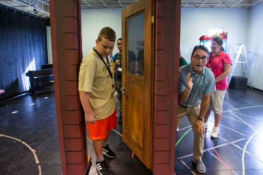 Golden Gate High School 9th grader Sonny Hogle participates in an acting exercise with Craig Price, director of community eduction and wellness at the Sugden Community Theatre, Monday, Oct. 7, 2019, in Naples.