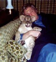Joe Friedman and Duke as a baby cub.
