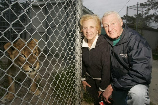 Joe and Geraldine Friedman in 2006,  near Porsche, who is the mate of a now deceased lion named Duke who they adopted from the former Jungle Habitat and raised in their Montclair home.
