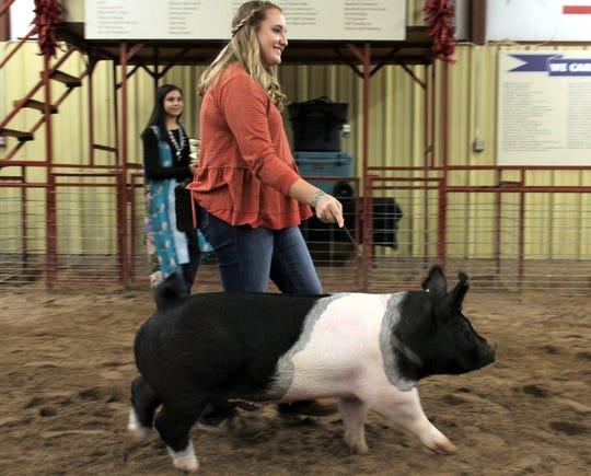 Karlie Hudson sold her champion hog to 5R Travel Center for $4,000.