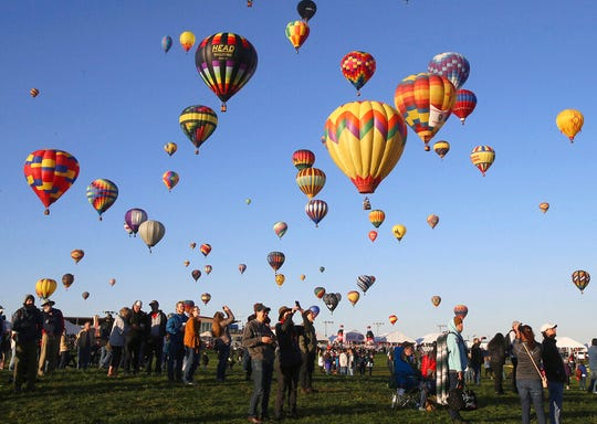 Spectators watch hot air balloons liftoff at the Albuquerque International Balloon Fiesta in Albuquerque, New Mexico, on Oct. 6, 2019.